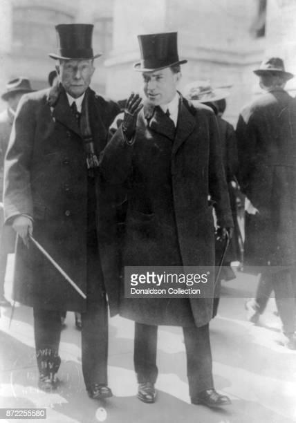 Businessman John D Rockefeller poses for a portrait walking with his son John D Rockefeller Jr in 1915
