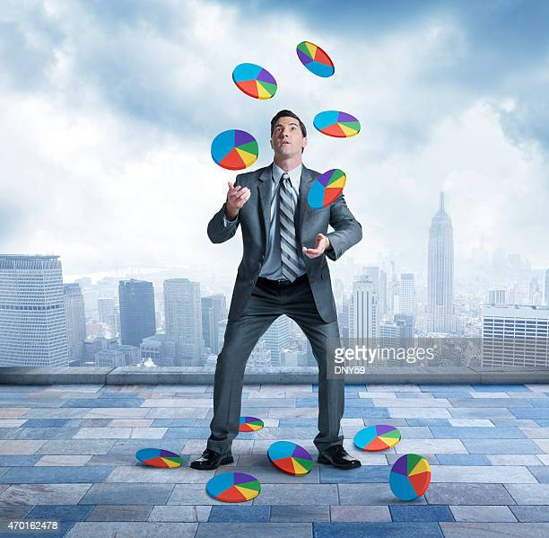 Businessman juggling and losing control