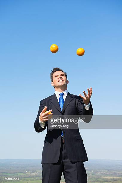 Businessman Juggling Oranges