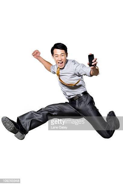 Businessman jumping in the air in celebration