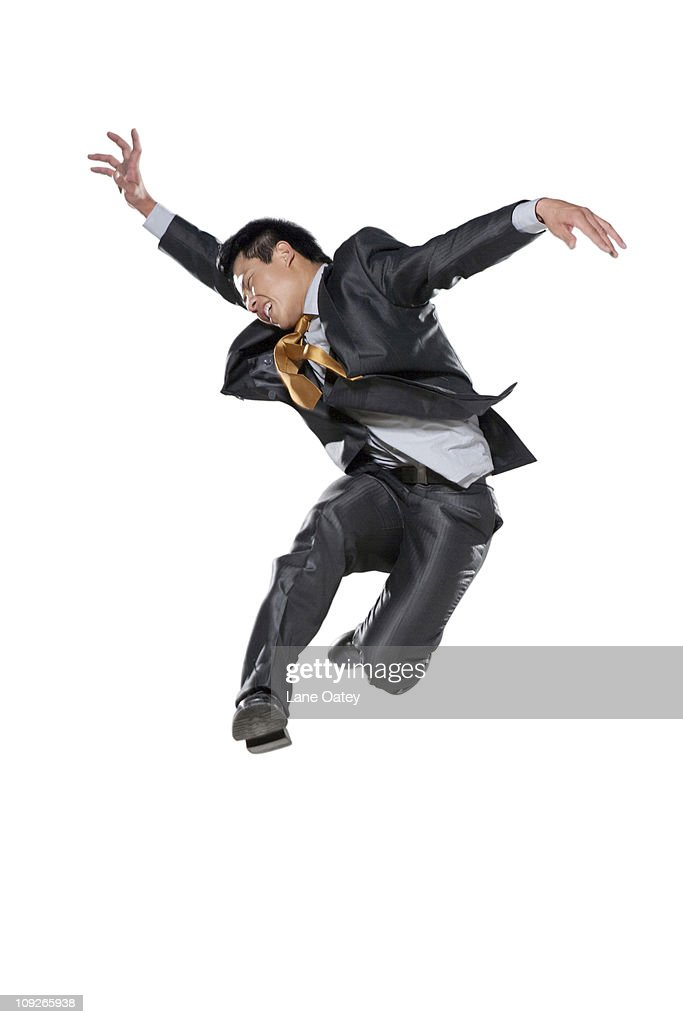 Businessman jumping in the air