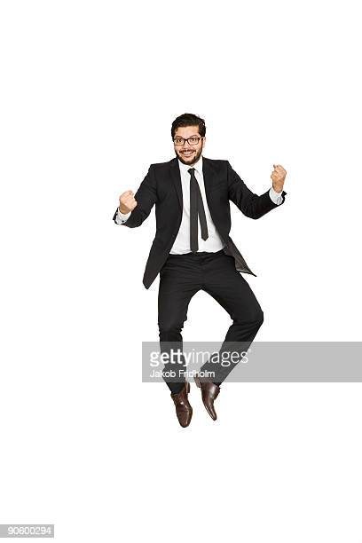 Businessman jumping of joy.