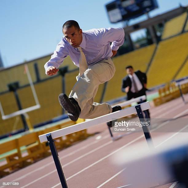 Businessman Jumping over Hurdles