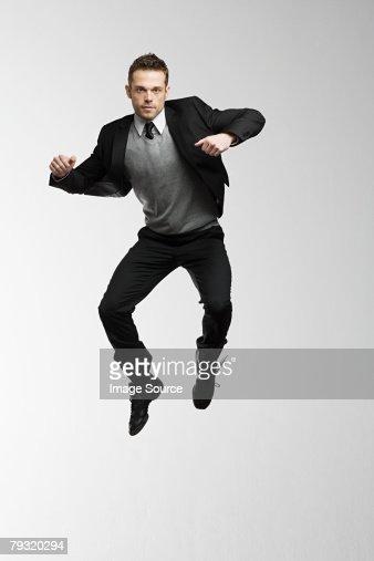 A businessman jumping