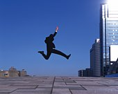 Businessman Jumping, Side View, Copy Space
