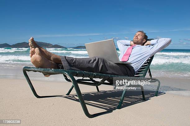 Businessman Kicks Back on Beach Chair