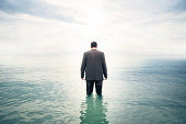 businessman is knee-deep in water