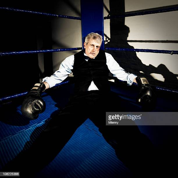 Businessman Knocked out in boxing ring corner