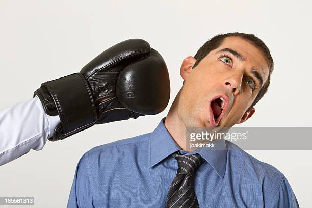 Businessman knocked out with boxing gloves