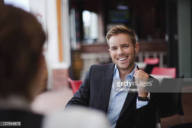 Businessman laughing at lunch