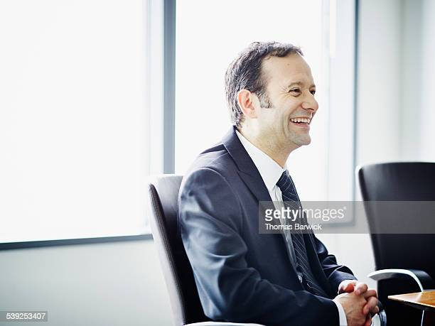 Businessman laughing during meeting in office