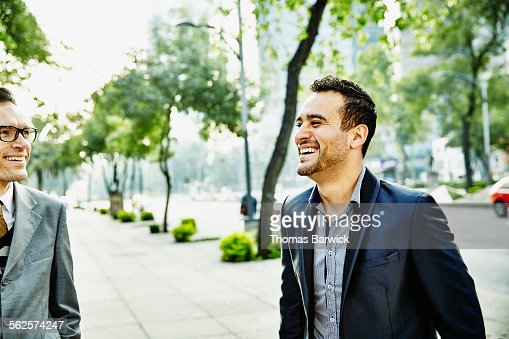 Businessman laughing during meeting with colleague