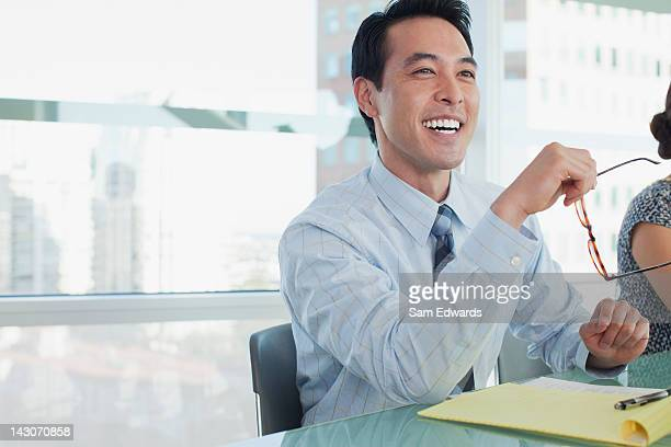 Businessman laughing in meeting