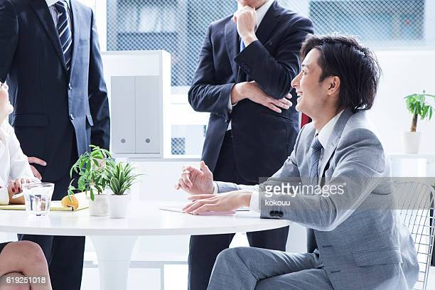 Businessman laughing in the office