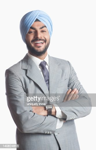 Businessman laughing with arms crossed