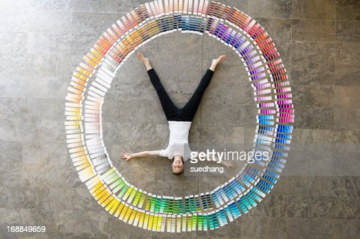 Businessman laying in paint swatches