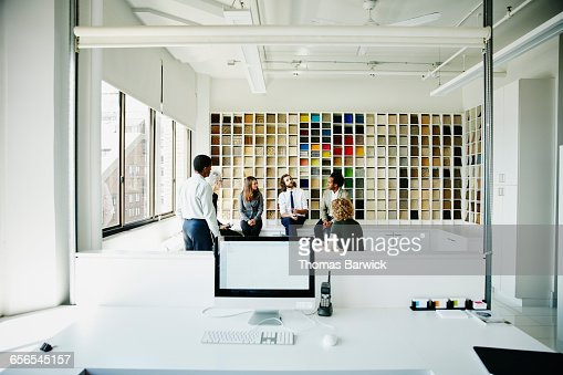 Businessman leading discussion during team meeting : Stock Photo