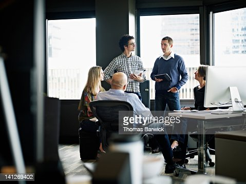 Businessman leading discussion in office : Stock Photo