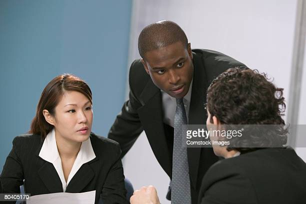 Businessman leading discussion with businesspeople