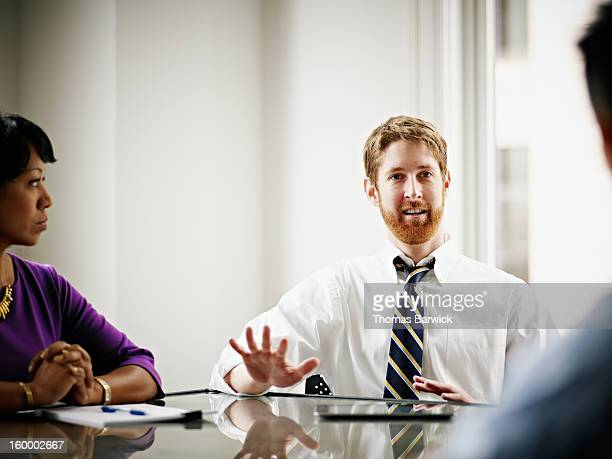 Businessman leading discussion with coworkers