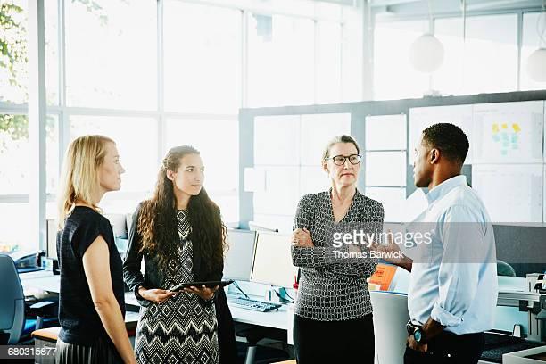 Businessman leading informal meeting in office