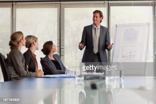 Businessman leading meeting in conference room : Stock Photo