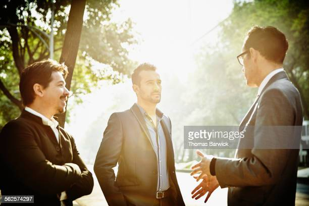 Businessman leading meeting with colleagues