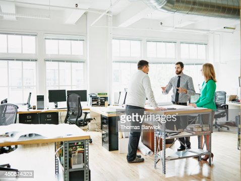 Businessman leading project discussion in office : Stock Photo