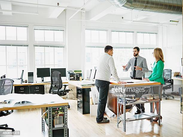 Businessman leading project discussion in office