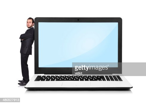 Businessman leaning on a laptop : Stock Photo