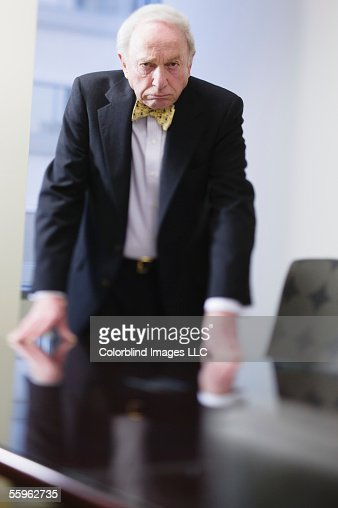 Businessman leaning on conference table