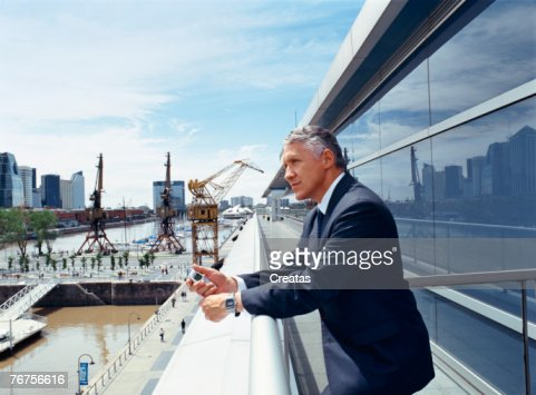 Businessman leaning on railing : ストックフォト