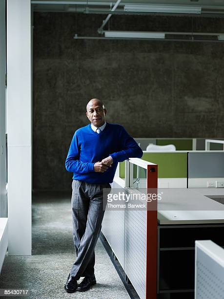 Businessman leaning on workstation