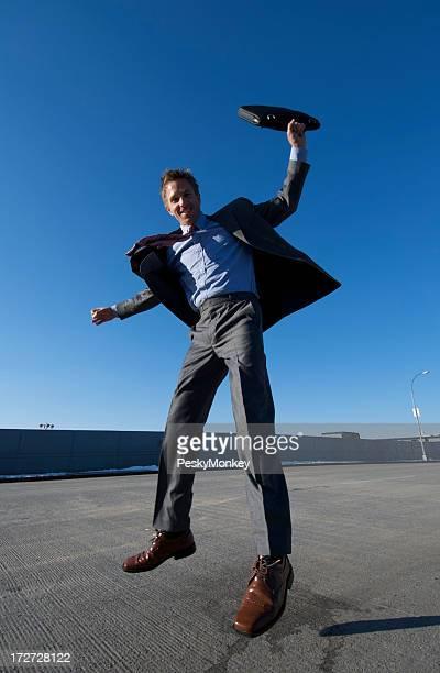 Businessman Leaps w Briefcase on Urban Background