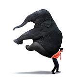 Images of businessman lifting heavy elephant - isolated on white background