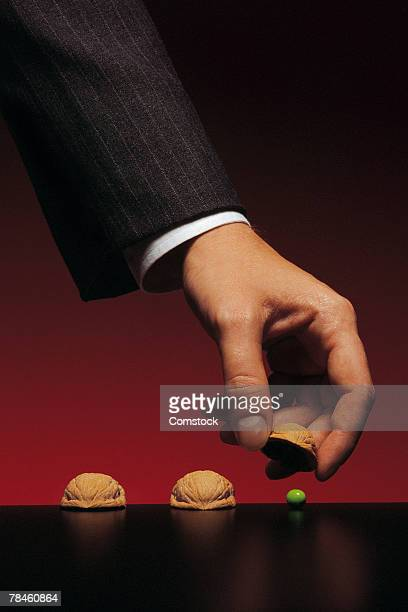Businessman lifting shell to show pea