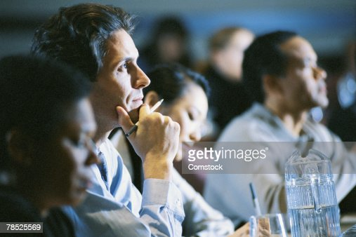 Businessman listening at conference