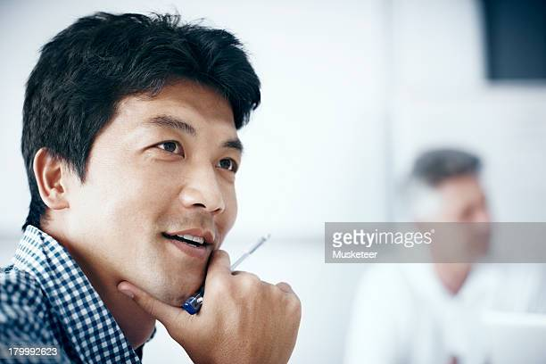 Businessman listening in a meeting