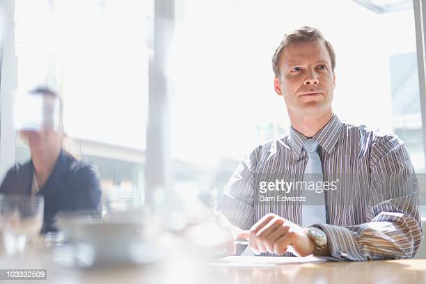 Businessman listening in meeting