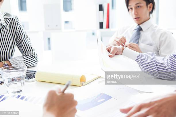 Businessman listening to the ideas of colleagues during a meeting