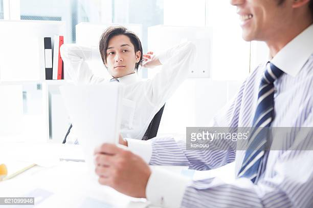 Businessman listening to the opinion of colleagues during a meeting