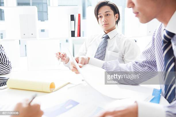 Businessman listening to the opinion of the boss