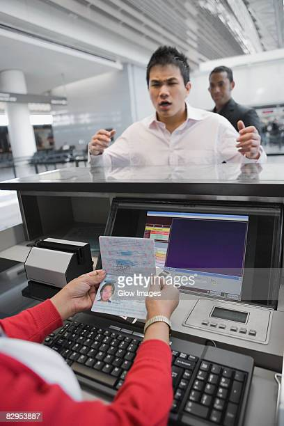 Businessman looking angry at a ticket counter in an airport