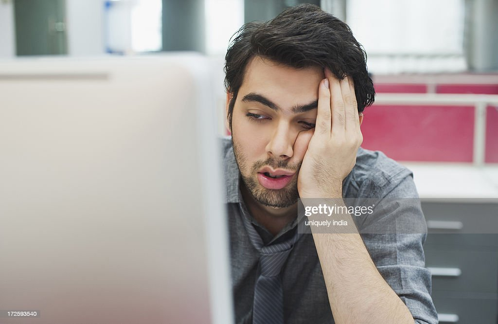 Businessman looking at a computer