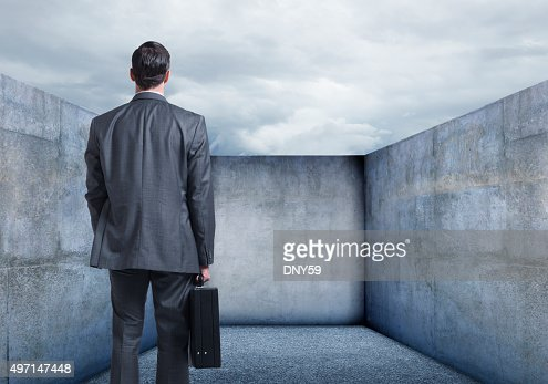 Businessman Looking At A Dead End