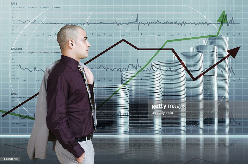 Businessman looking at a line graph : Stock Photo