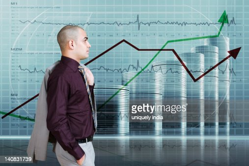 Businessman looking at a line graph : Bildbanksbilder