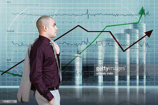 Businessman looking at a line graph