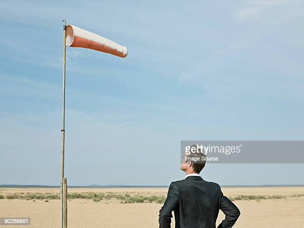 Businessman looking at a windsock