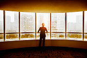 Businessman looking at city in modern office